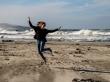 Feliz en la playa, alrededores de Dunedin